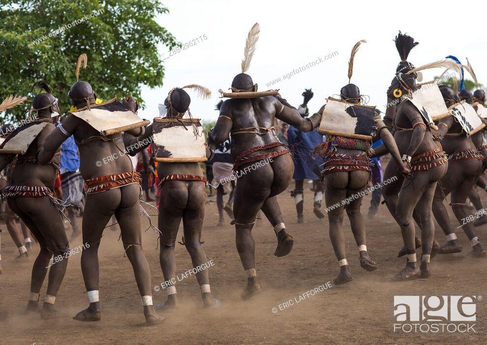 Stock Photo: Bodi tribe fat men dancing during Kael ceremony, Omo valley, Hana Mursi, Ethiopia.