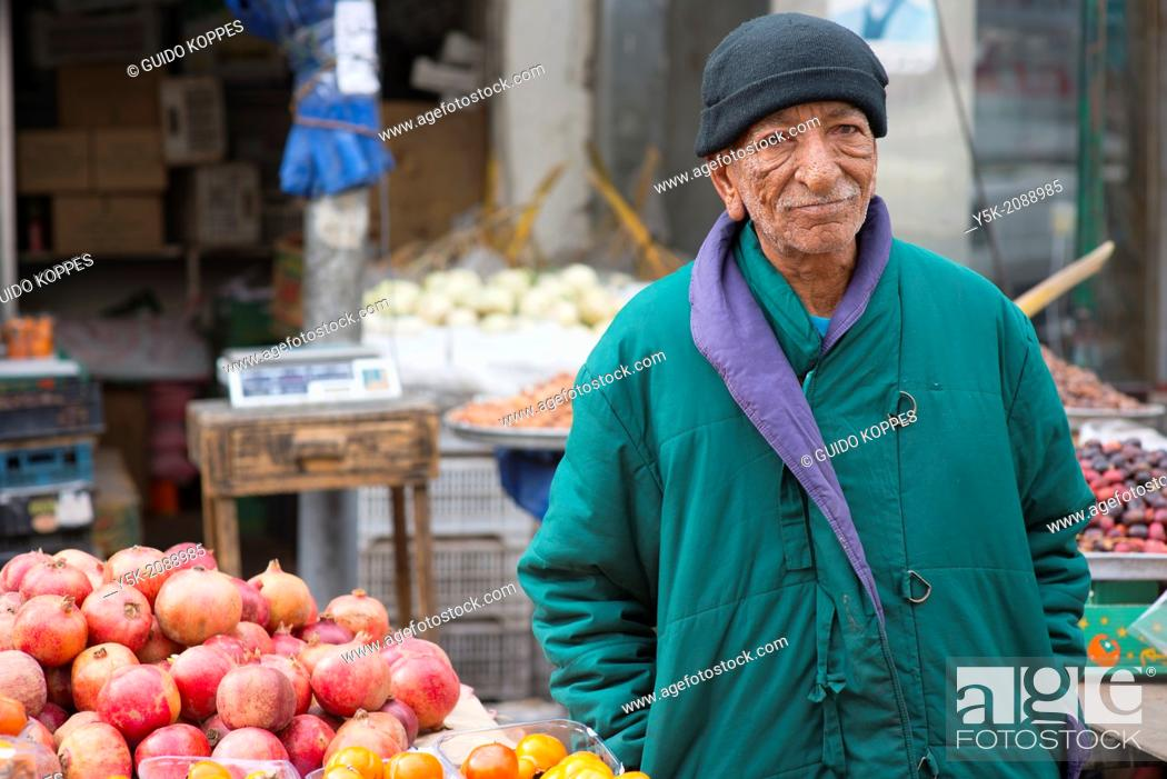 Stock Photo: Down Town, Amman, Jordan, Middle-East. Seventy (70) year old owner of a market stall, down town Amman, where he sells regionally produced fruits and vegetables.