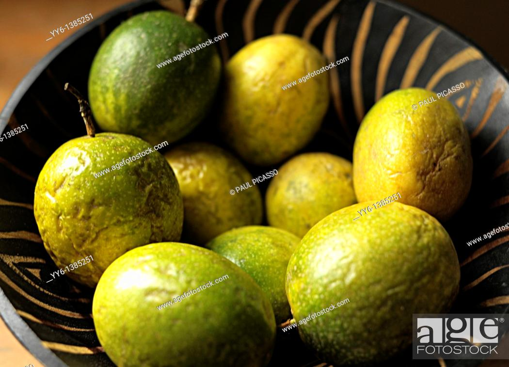 Stock Photo: passion fruit in wooden fruit bowl.