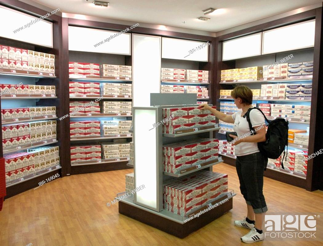 Customer in front of cartons of Cigarettes in Duty-Free Shop