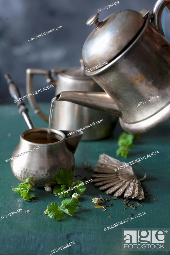 Stock Photo: Tea making in silver jug.