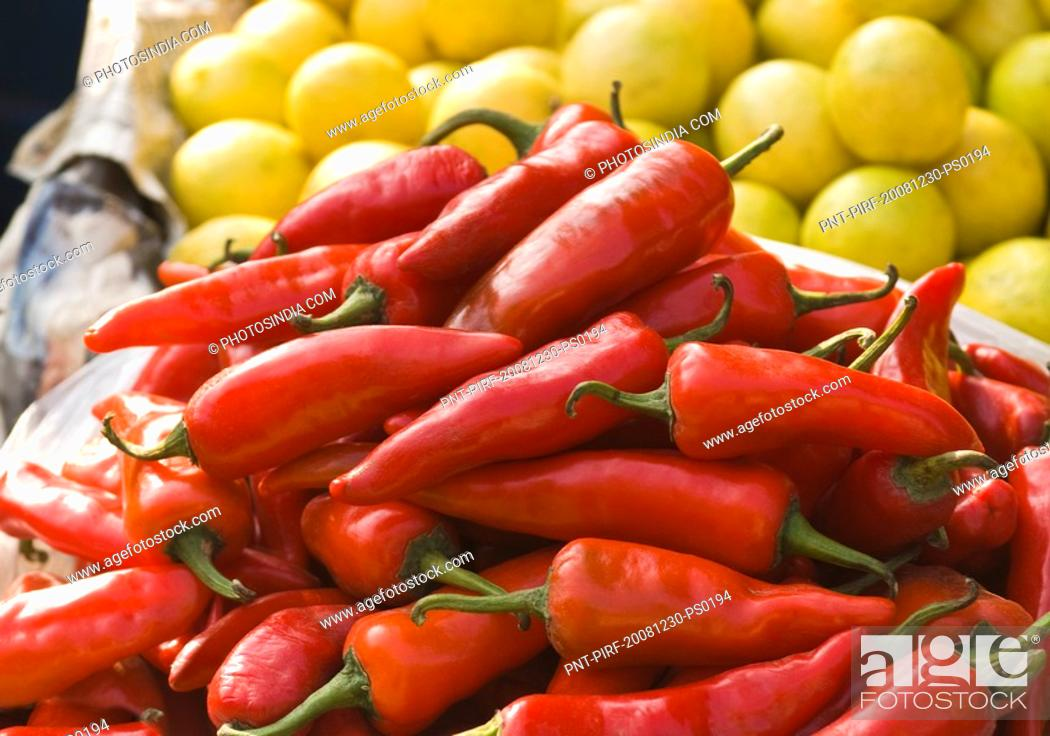 Stock Photo: Red chili peppers and gooseberries at a market stall, Delhi, India.