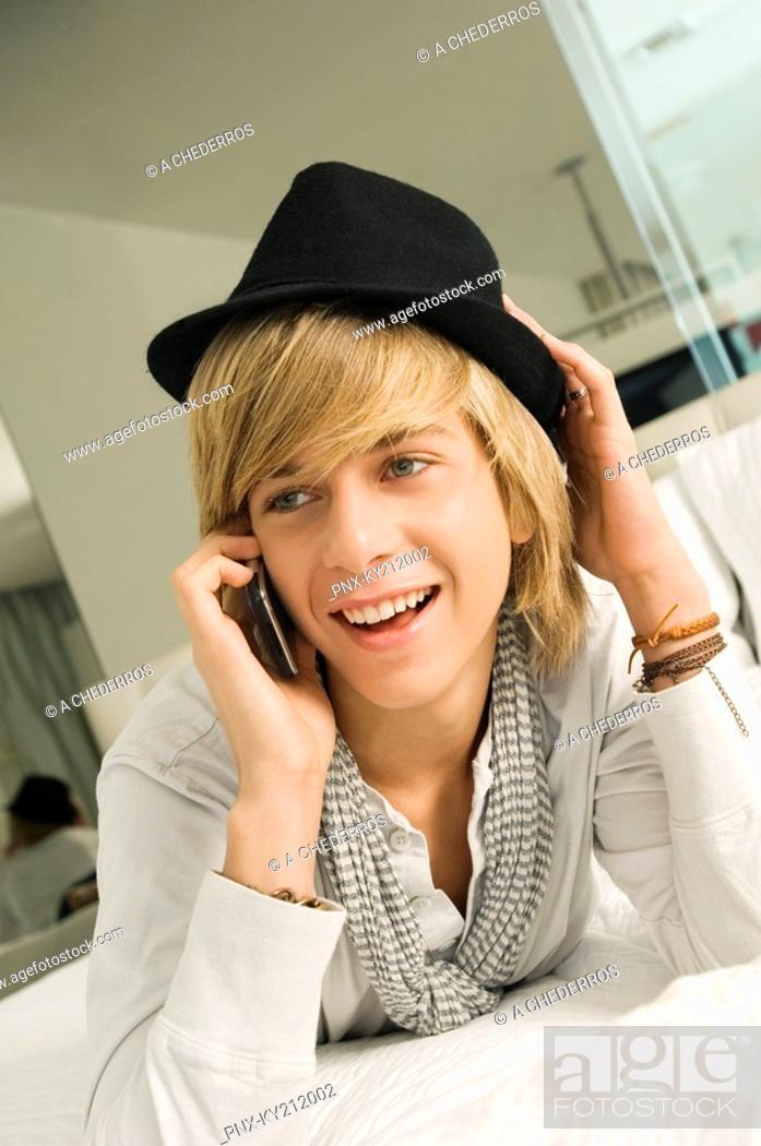 Stock Photo: Teenage boy talking on a mobile phone.