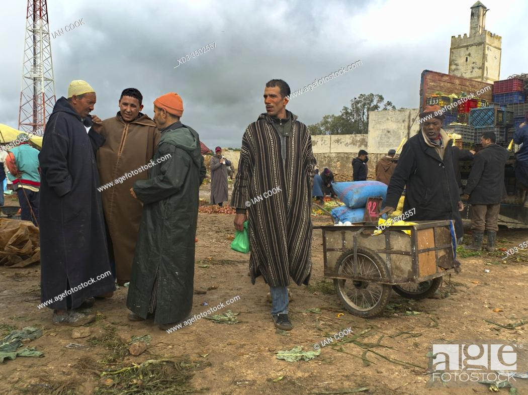 Stock Photo: men in tradidional dress at the market in Ida Ougourd Market, near Essaouira, Morocco.