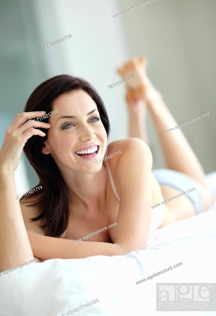 Stock Photo: Sexy woman lying on bed.