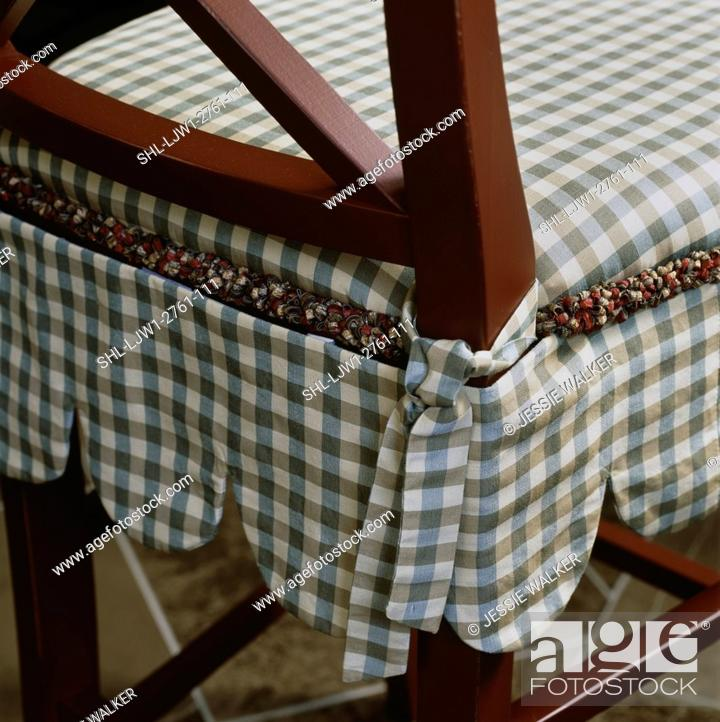 Stock Photo: Detail Of Skirted Chair Cushion With Blue And Light Brown  Checkered Pattern,