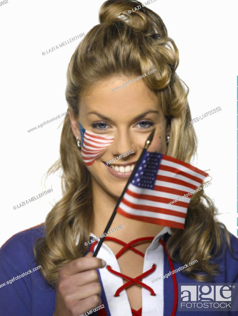 Imagen: Young woman holding US flag, portrait.