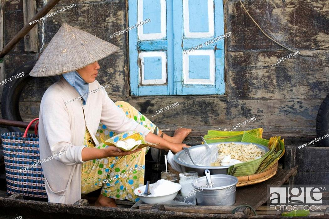 Stock Photo: Floating Market, woman in a boat on the Mekong River at Tra On, Mekong Delta, Can Tho Province, Vietnam, Asia.