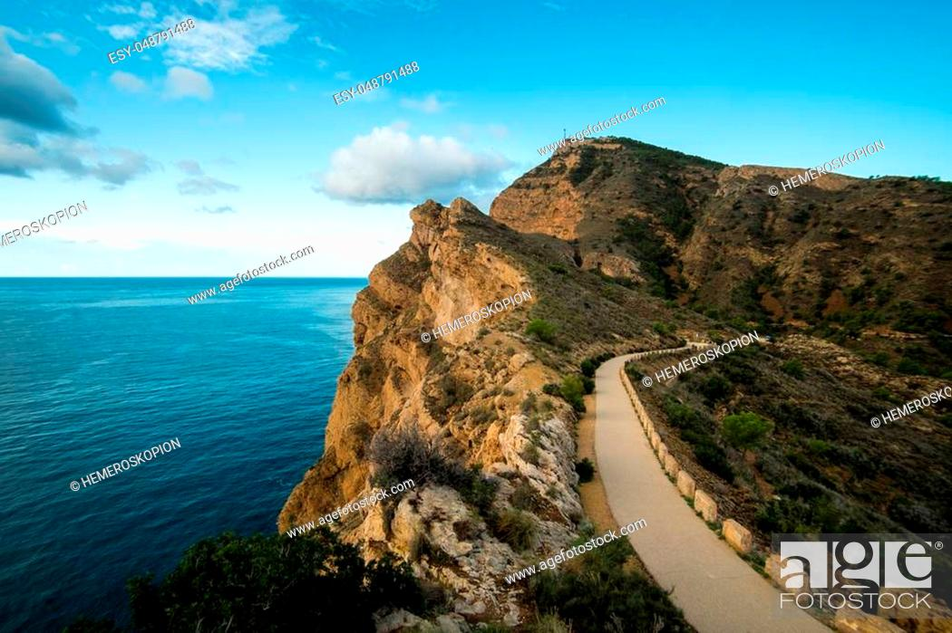Stock Photo: Sierra Helada cliffs and scenic road to its lighthouse overlooking Altea bay, Costa Blanca, Spain.