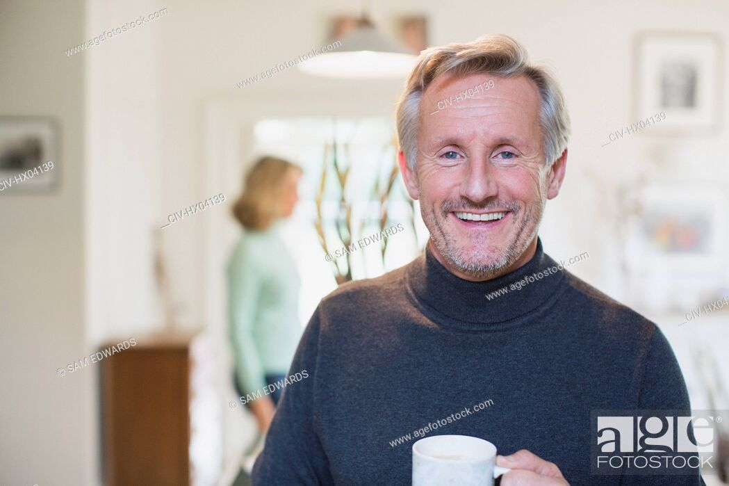 Stock Photo: Portrait smiling, confident mature man drinking tea.