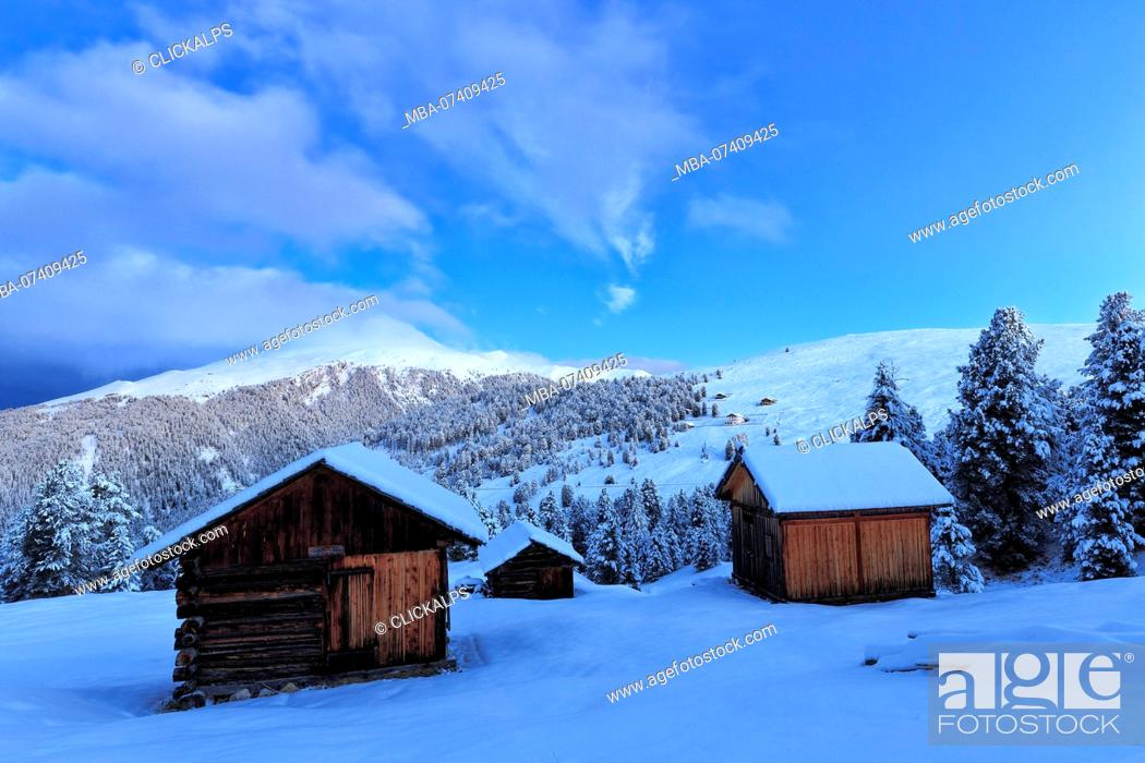 Stock Photo: Old snow-covered huts during twilight. Erbe Pass, Funes Valley, South Tyrol, Dolomites, Italy.