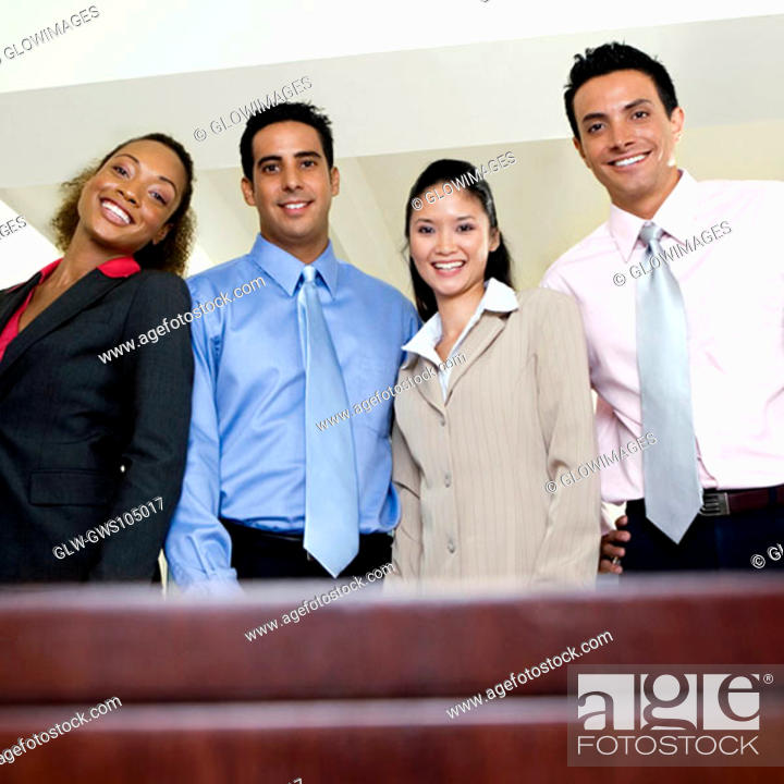 Stock Photo: Portrait of two businesswomen and two businessmen smiling.