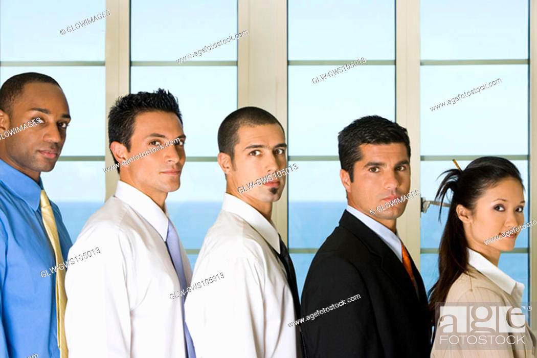 Stock Photo: Side profile of four businessmen standing with a businesswoman.