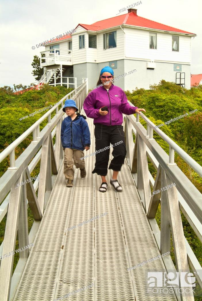 Stock Photo: a mother and her son on the bridge leading to the lighthouse at Friendly Cove, BC, Canada.