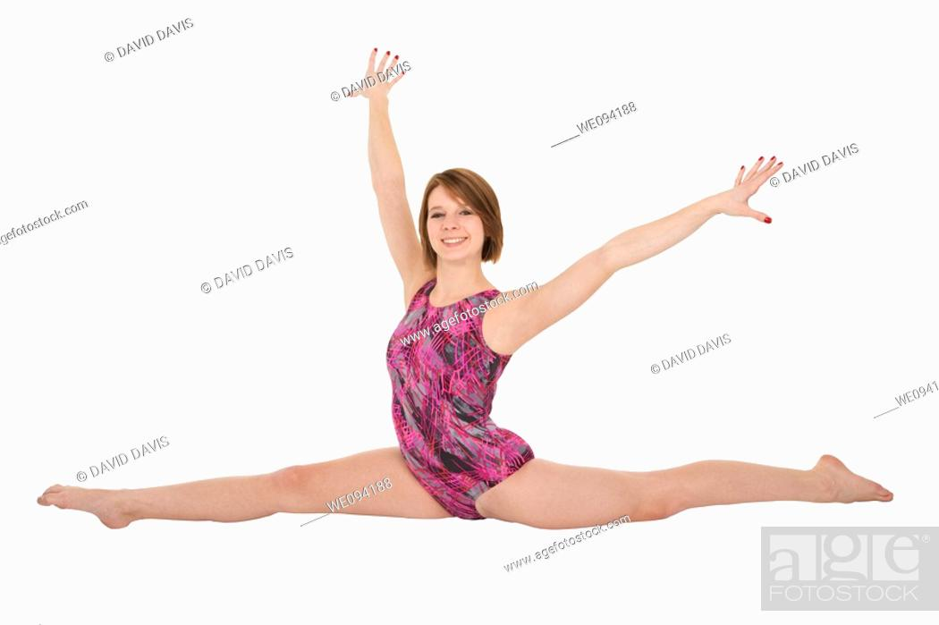 Stock Photo: Caucasian teenage girl in gymnastic poses on white background.