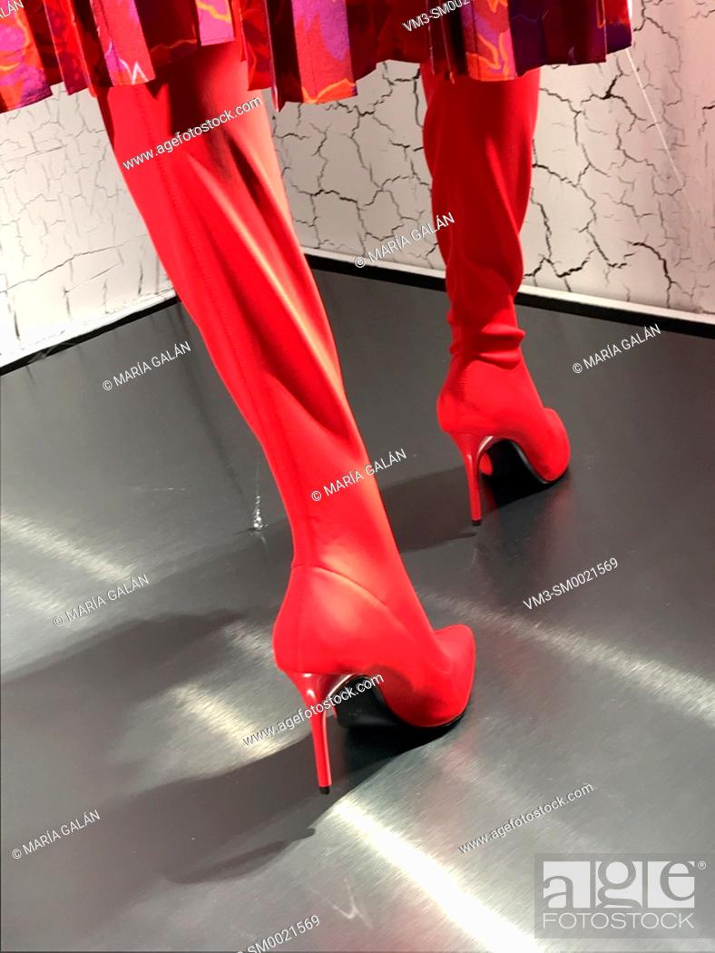 Stock Photo: Mannequin's feet wearing red high-heeled boots in a shop window. Serrano street, Madrid, Spain.