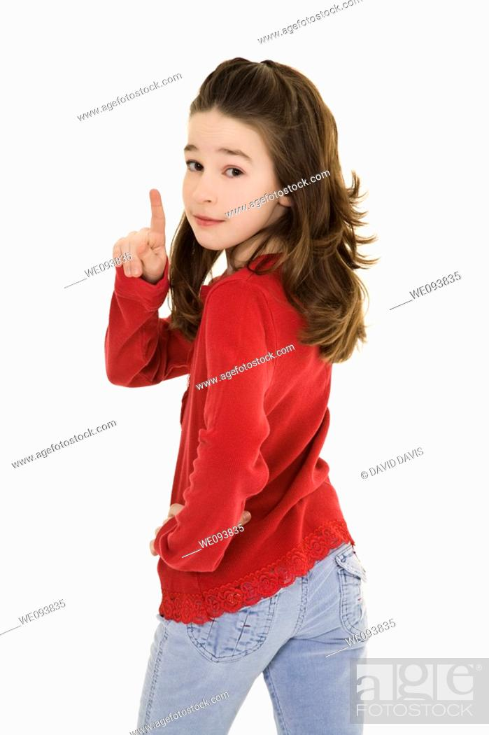 Stock Photo: Caucasian preteen using her finger to display some attitude.