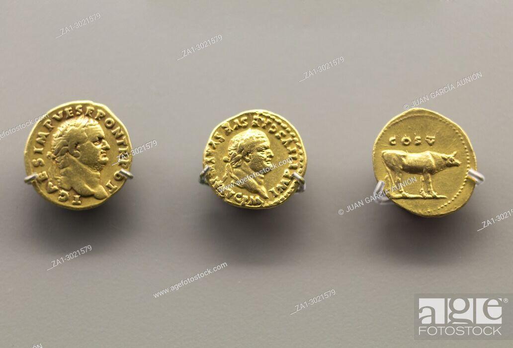 Stock Photo: Merida, Spain: Three golden coins of Titus Emperor at National Museum of Roman Art in Merida, Spain.
