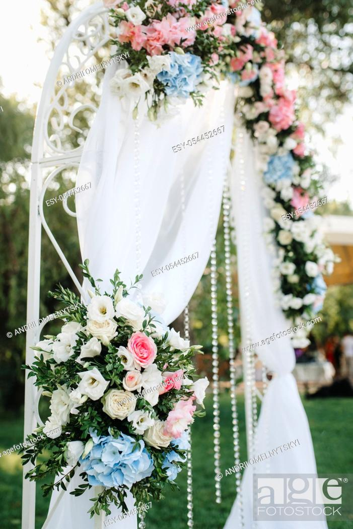 Stock Photo: wedding ceremony area, arch chairs decor.