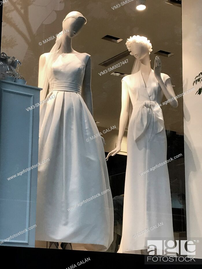 Stock Photo: Two mannequins wearing wedding dresses in a shop window. Madrid, Spain.