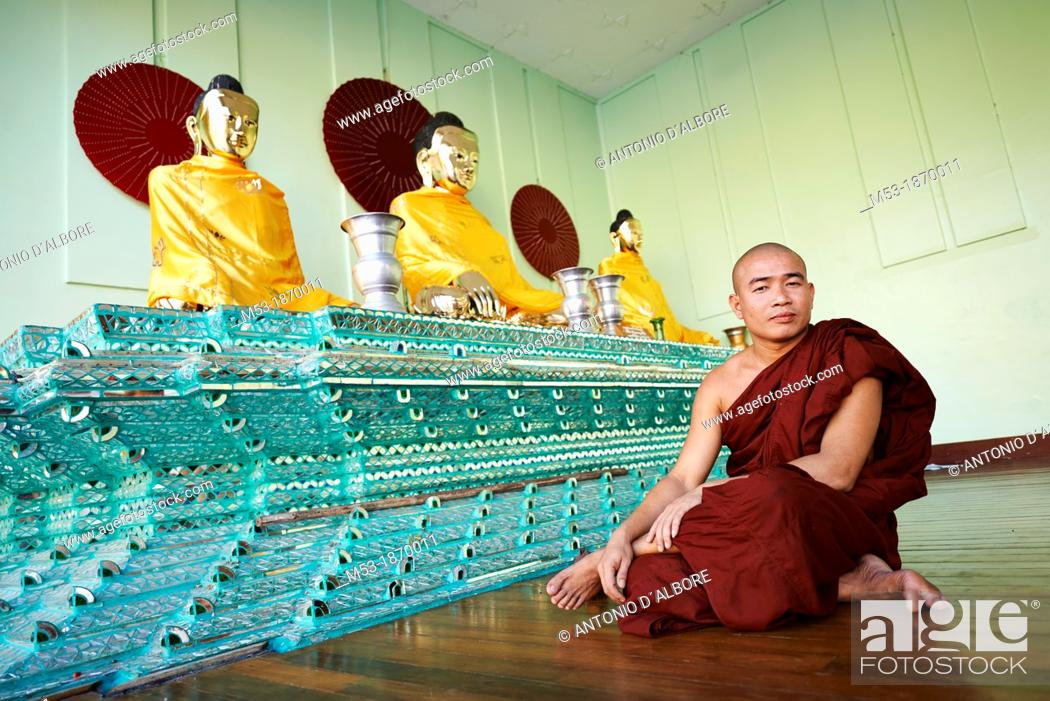 Stock Photo: A burmese buddhist monk sit in a praying room inside the Shwedagon Pagoda complex  Yangon  Myanmar.
