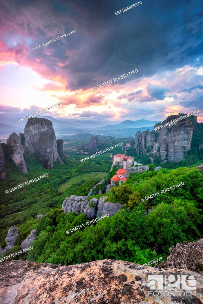 Stock Photo: Sunset sky and monastery of Rousanou and Monastery of St. Nicholas Anapavsa in famous greek tourist destination Meteora in Greece with dramatic sky.