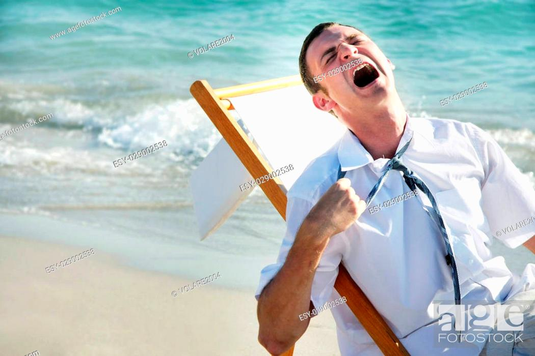 Stock Photo: tired businessman on sea background.