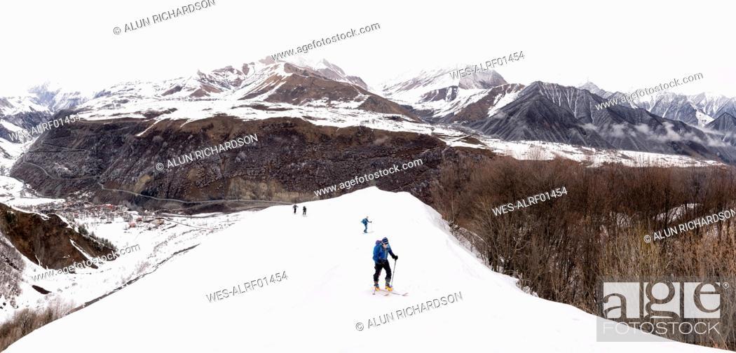 Stock Photo: Georgia, Caucasus, Gudauri, people on a ski tour to Lomisi Monastery.