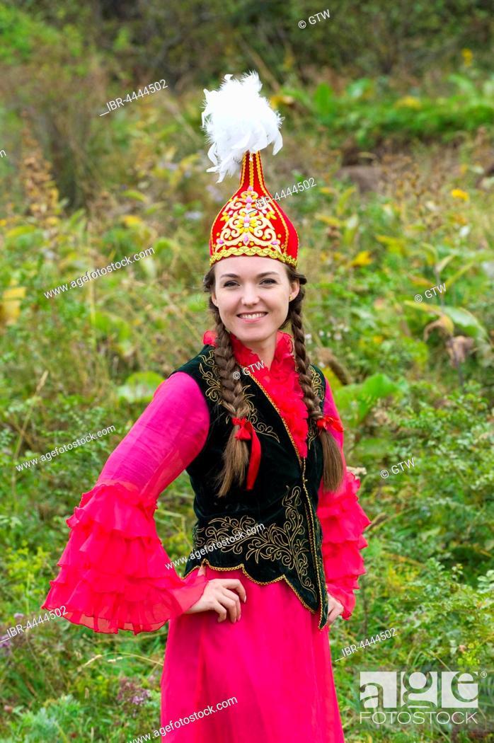 Stock Photo: Young Kazakh woman, Kazakh ethnographic village aul Gunny, Talgar, Almaty, Kazakhstan.