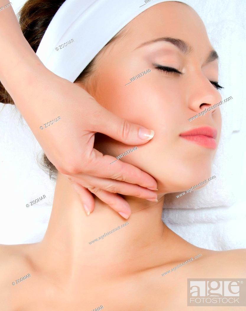 Stock Photo: Facial massage to the woman closeup.
