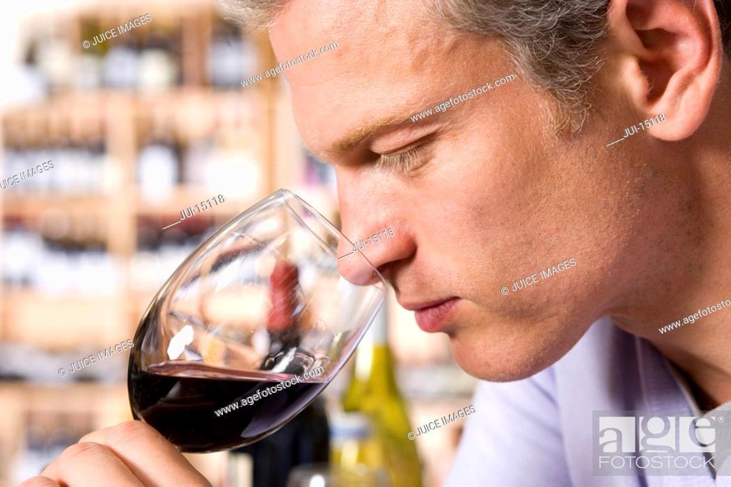Stock Photo: Man wine tasting.