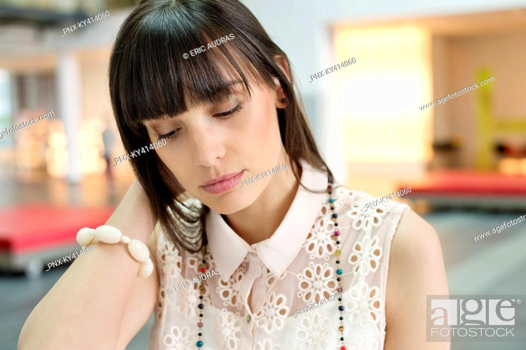 Stock Photo: Close-up of a businesswoman looking tired.