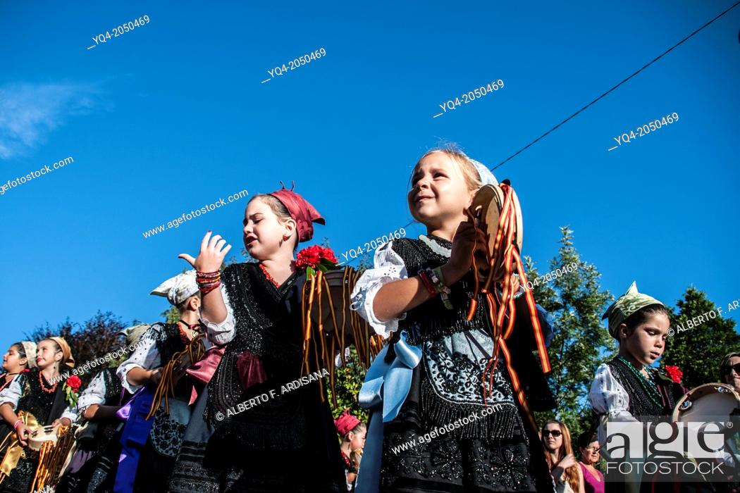 Stock Photo: Girls parading dressed in traditional costume during the holiday Llanes. Asturias Spain.