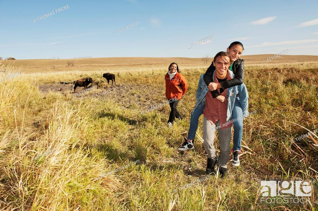 Stock Photo: Native American family walking through a buffalo ranch; Rossburn, Manitoba, Canada.