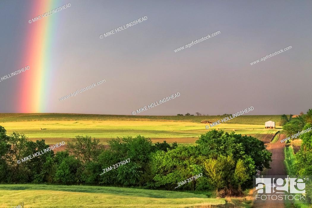 Stock Photo: Rainbow shines over the countryside in northern Kansas.