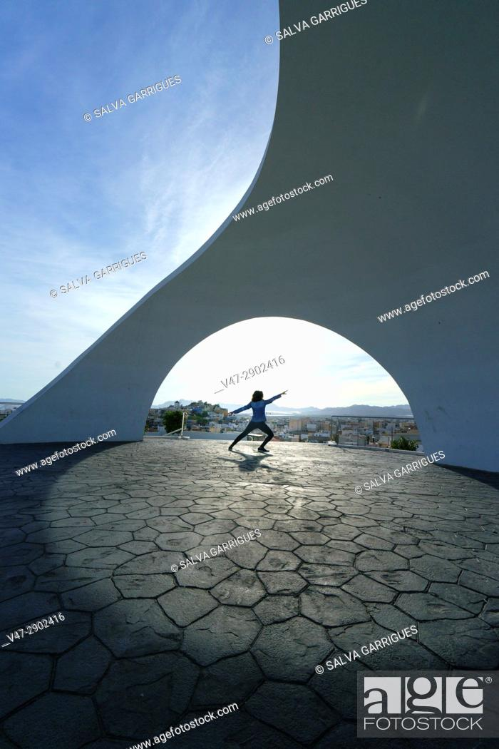Stock Photo: Woman dancing at Viewpoint of La Calica de Aguilas, Murcia, Spain.