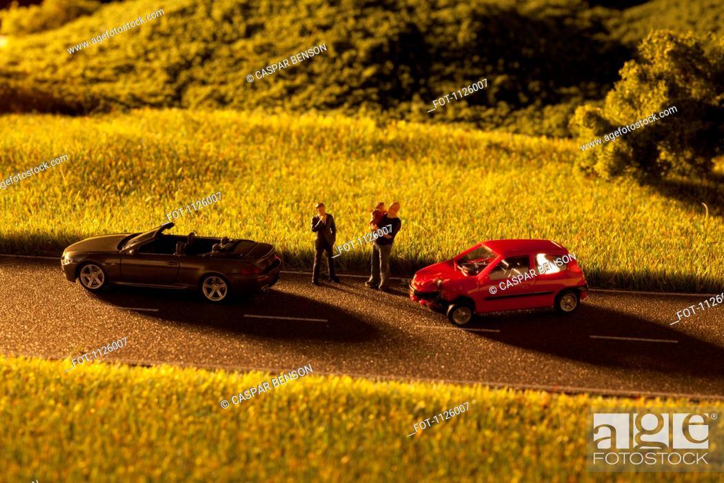 Stock Photo: Diorama of a toy car crash.