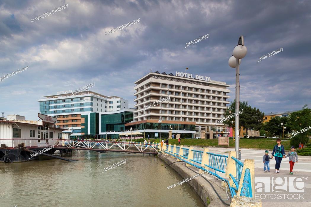 Stock Photo: Romania, Danube River Delta, Tulcea, waterfront buildings by Danube River.