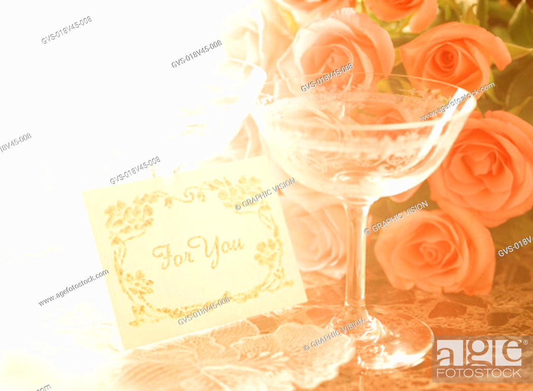 Stock Photo: Close Up of a Wine Glass and Roses.
