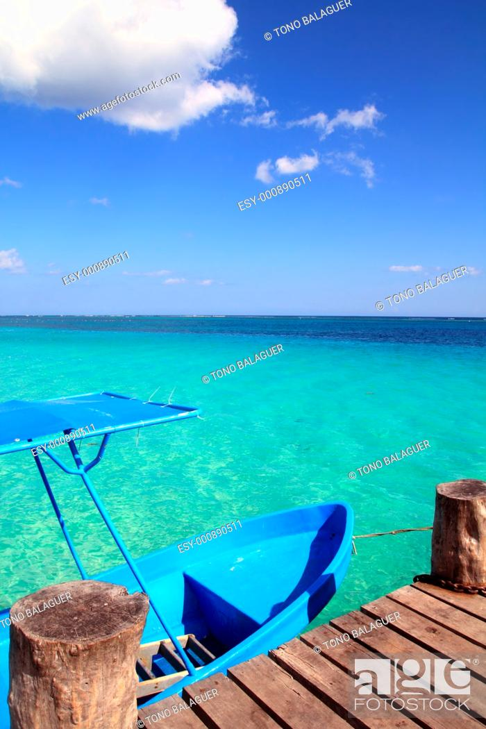 Stock Photo: blue boat in wooden tropical pier in Caribbean beach.