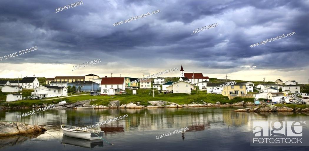 Stock Photo: Clouds over village in Nova Scotia.