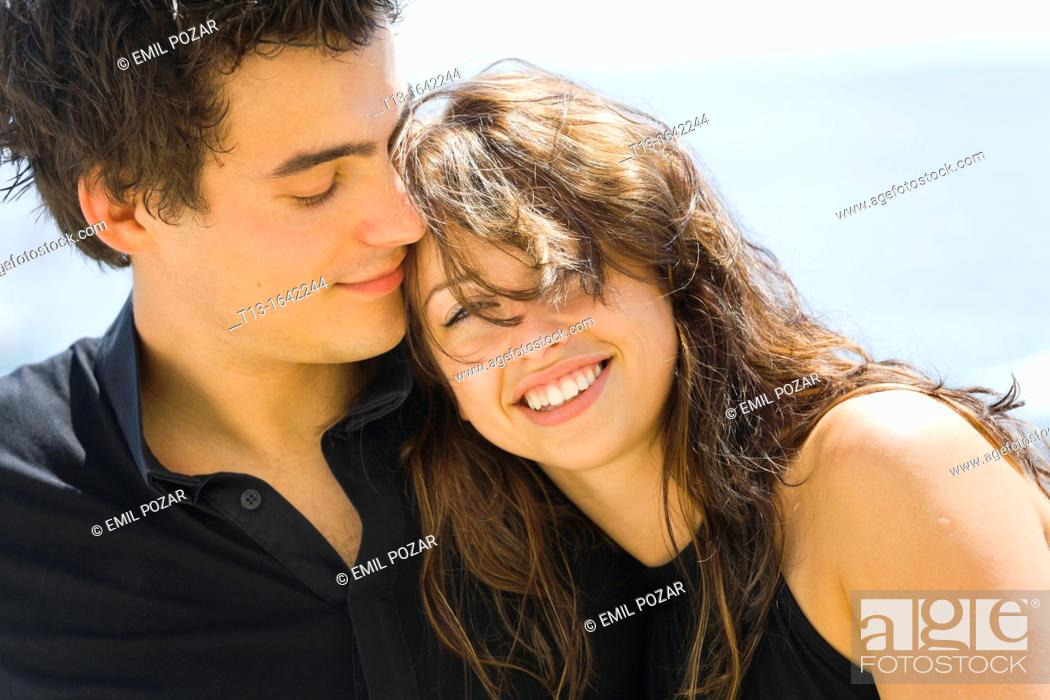 Stock Photo: Young couple tight portrait.