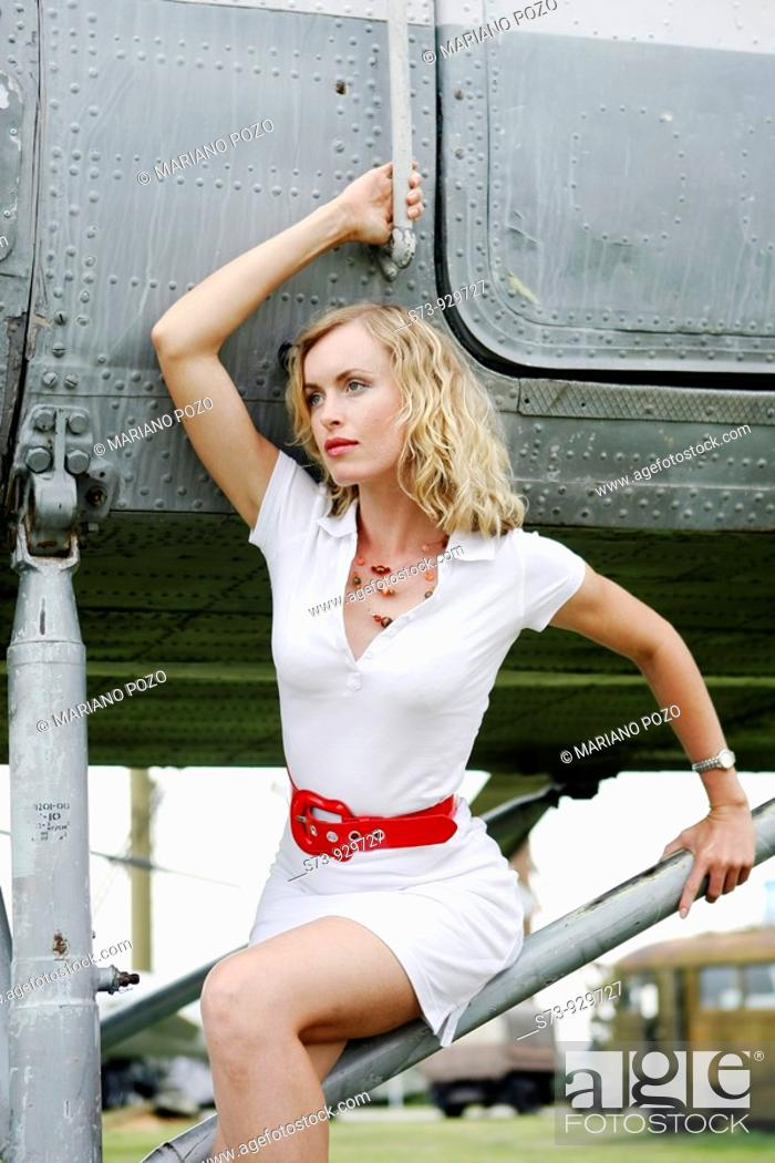 Stock Photo: Woman sitting on a helicopter.