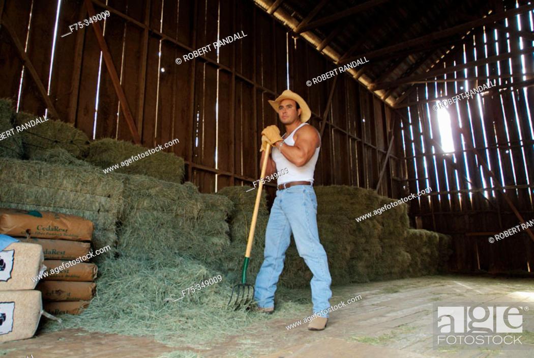 Stock Photo: Rancher bailing hay. Poway, California. USA.