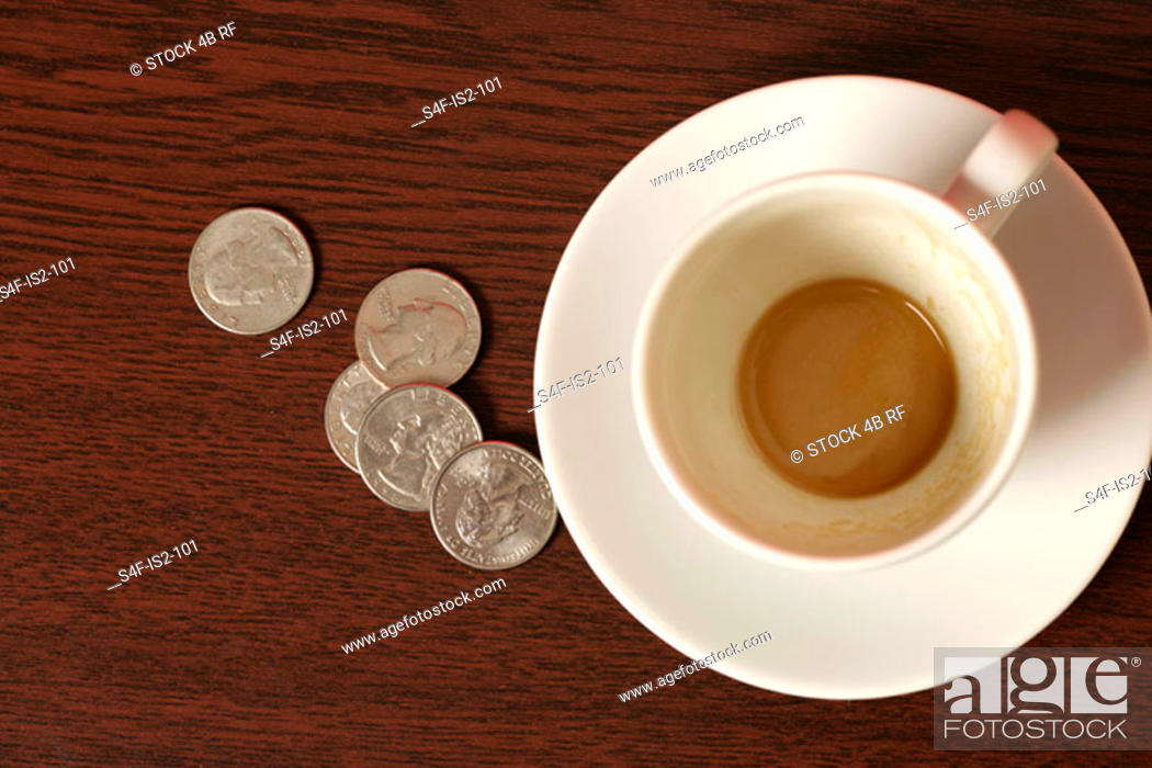 Stock Photo: Coffee cup and tip on a wooden underlay, close-up.