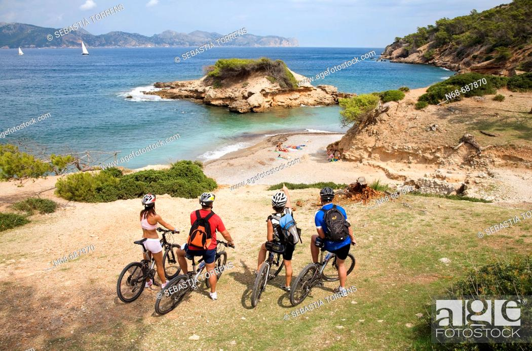Stock Photo: Group of cyclist at Alcudia, Majorca. Balearic Islands, Spain.