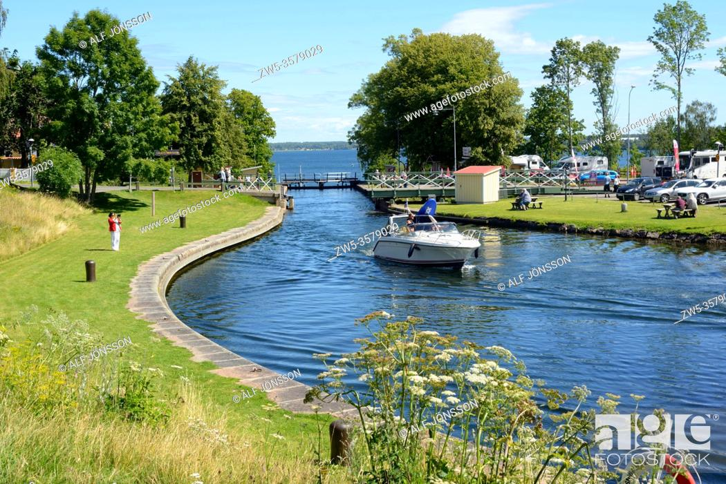 Stock Photo: Leisure boats leave the locks in Gota Canal at Borenshult, Motala, Östergötland, Sweden. The Gota Canal was constructed in the 19th century.