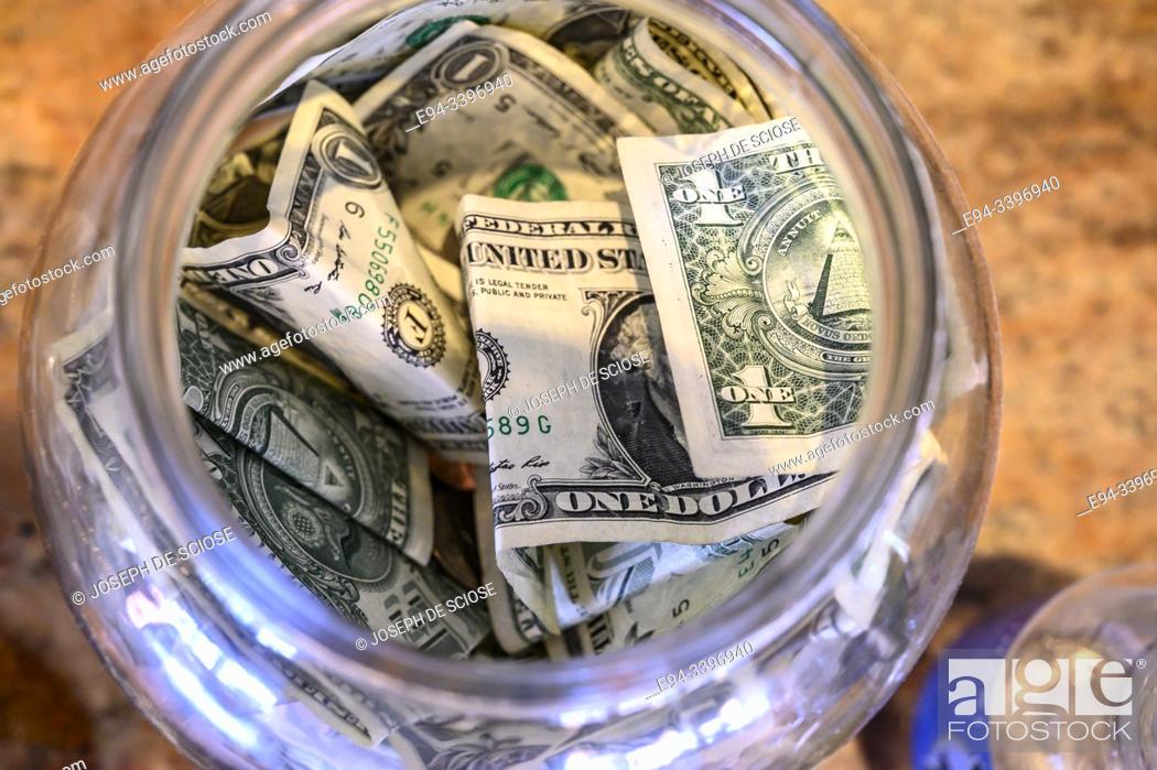 Photo de stock: Money in a tip jar in a restaurant.