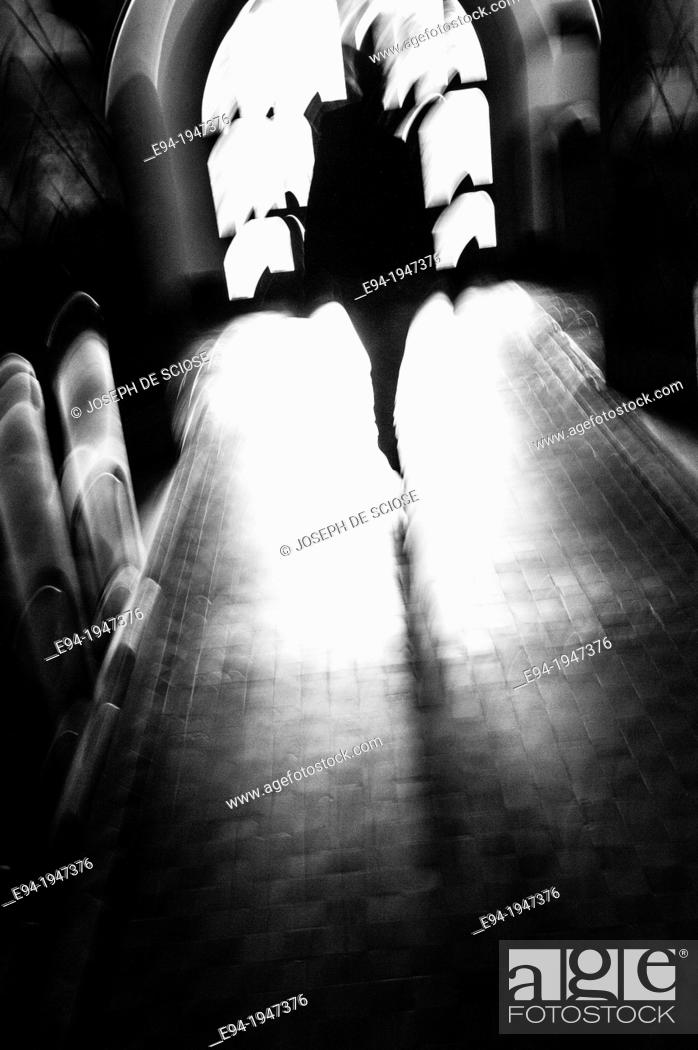 Silhouette Of A Distorted Human Figure In The Center Aisle Of A