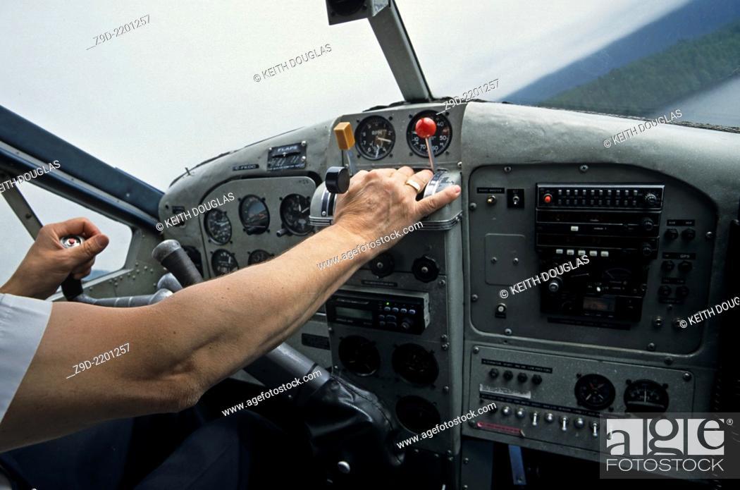 Stock Photo: Cockpit and pilot of Otter floatplane, Prince Rupert, British Columbia.